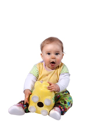sitting Baby is surprised because there is no money in the piggy bank Stock Photo - 13770693