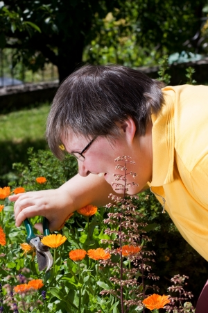 mentally disabled woman cut flowers in the garden photo