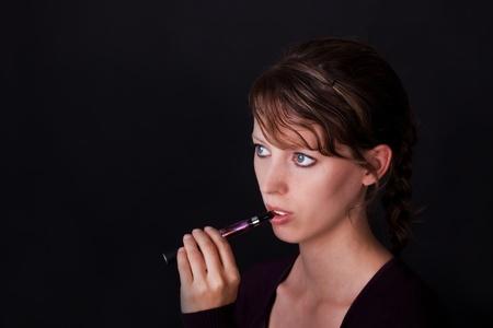 e cigarette: pretty young woman with electric cigarette