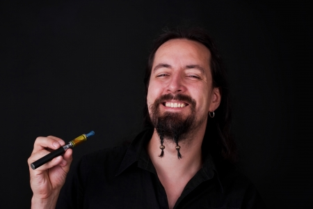 attractive man with e-cigarette looks happy Stock Photo
