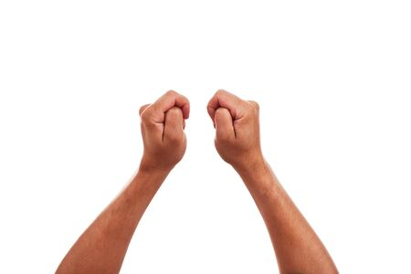 jubilate: two hands are crossing fingers to bring good luck Stock Photo