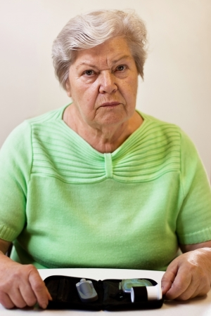 old woman with equipment of blood sugar test Stock Photo - 14407523