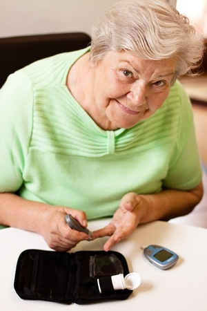 old woman in blood sugar measure photo