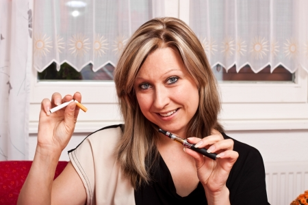 Blonde pretty woman chooses an electronic cigarette and destroys the normal photo