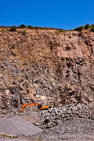 degrading: a quarry and backhoe