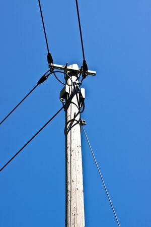 a old phone mast and blue sky photo