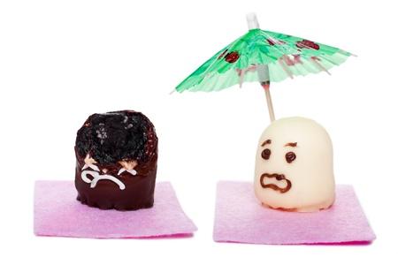 skin cancer: two marshmallows concept dangerous sunbathe