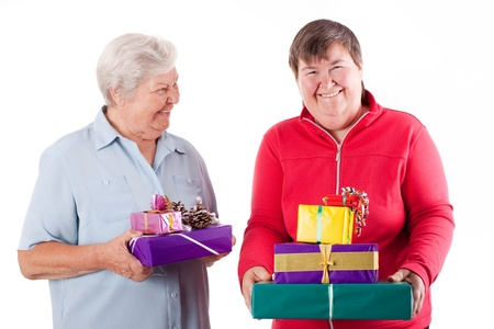 mentally: senior and mental disabled woman holding gifts Stock Photo