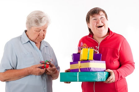 mentally: female senior have only one gift, daughter with a lot Stock Photo
