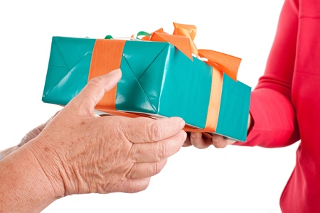 closeup, hands reaching each other a gift, studio shot Stock Photo - 15329352