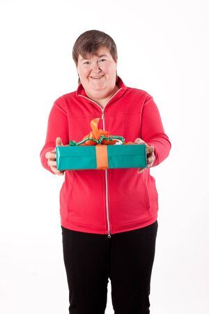 mentally disabled women gets or give a present Stock Photo - 15338541