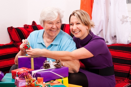 old and young woman with gifts Stock Photo - 15334770