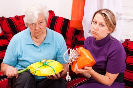 uninspired: old and young woman are getting uninspired gifts Stock Photo
