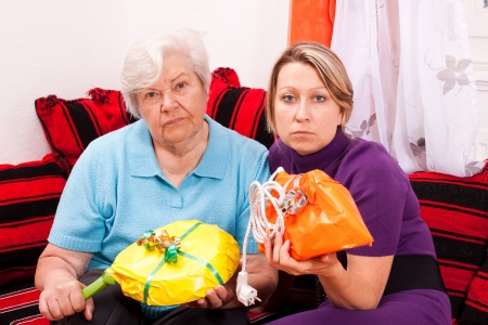 uninspired: old and young woman are getting improper gifts