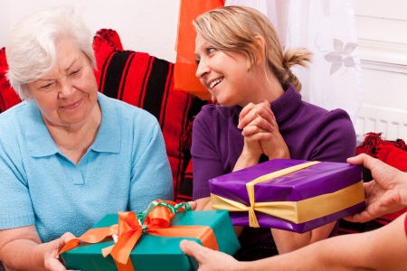 two different old women gets a lot of gifts photo