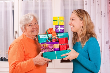 gives: senior and young female holding gifts