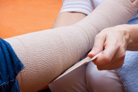 beautiful legs: Nurse bandaged the foot of an  elderly patient Stock Photo