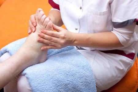 wellbeeing: female Nurse treats a patients foot Stock Photo