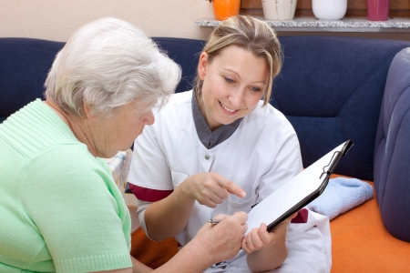 80 year old: female doctor with an elderly woman makes an checkup Stock Photo