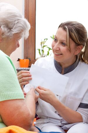 female nurse handed patient an letter Stock Photo - 15812348
