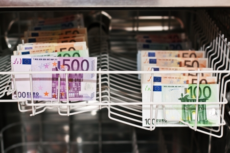 money laundering in the dishwasher with banknotes photo
