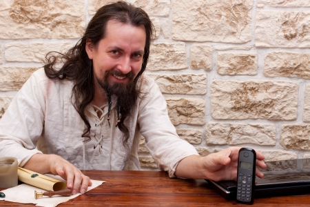 medieval dressed man chooses technology photo
