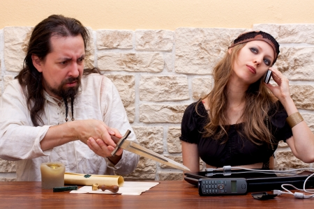 woman and man have different views on the subject of technology photo