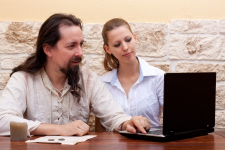 Man learns from woman dealing with laptop Stock Photo - 16972482