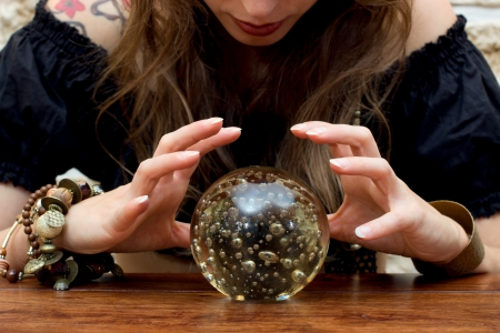 Young fortune teller indicated something in a ball Stock Photo - 16972478