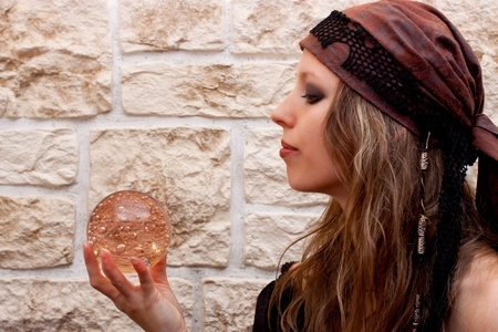 psychic reading: Side view of a pretty female fortune teller