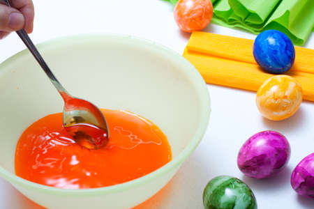 orange liquid color in bowl for easter eggs photo