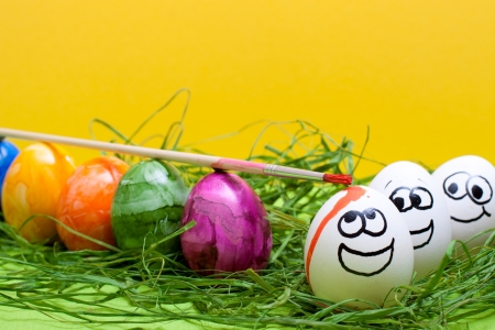 yellow easter background with funny eggs photo