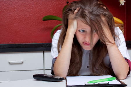 doctor burnout: brunette nurse is stressed Stock Photo