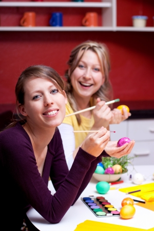 Two pretty young women smiling with Easter eggs Stock Photo - 17055360