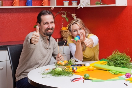 adult couple with colorful Easter eggs lifts thumb photo