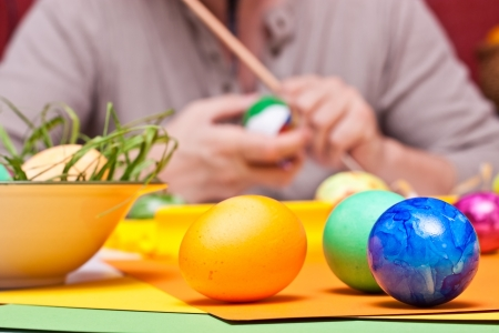 closeup of male hands and colorful Easter eggs photo
