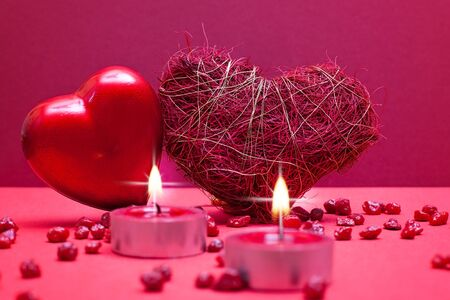 Romantic red background with hearts and textile photo