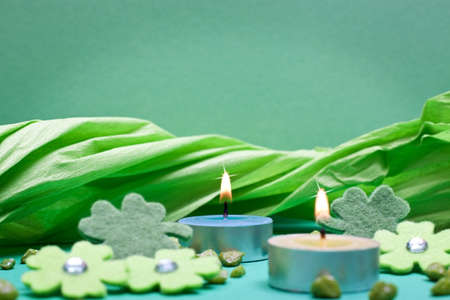 festive occasions: green background with candles for festive occasions Stock Photo
