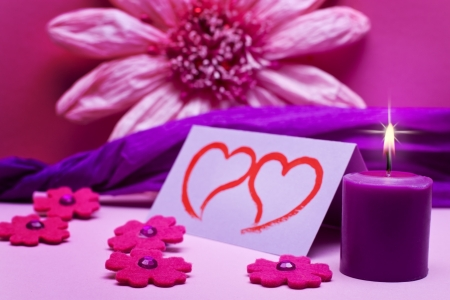 romantic purple background with candle photo