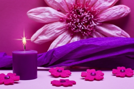 romantic pink background with flowers and candle photo