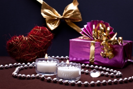 festive background with gift, heart and candles photo
