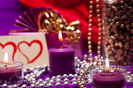 romantic and luxurious background with candles and pearls photo