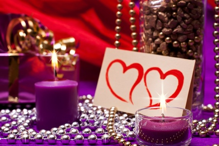 romantic background with beads and candles photo