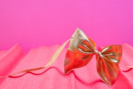 romantic pink background with golden ribbon photo