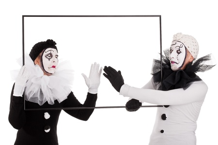 a couple clowns cleaning an empty picture photo