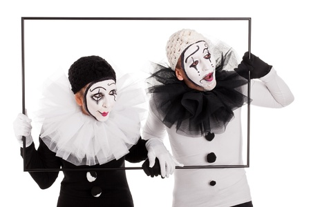 couple of clowns in a frame looking in the same direction