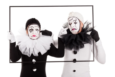 couple of clowns in a frame cant hear each other