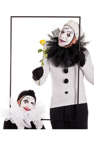 mimic: two clowns in a frame with a flower Stock Photo
