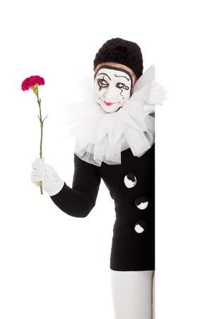 pierrot: pretty female clown with flower in hand Stock Photo