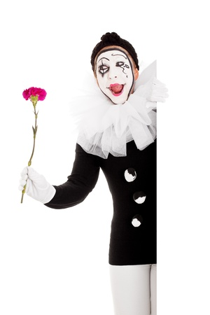 mimic: funny female clown with flower looks happy